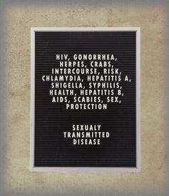 foto of std  - STD concept in plastic letters on very old menu board vintage look - JPG