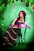 picture of loach  - Beautiful young woman sitting under an arch of flowers and overgrown loach - JPG