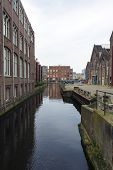 stock photo of sabbatical  - An urban water canal landscape in Amsterdam - JPG