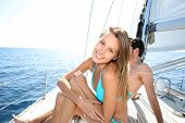 Cheerful beautiful woman enjoying sail cruising