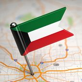 stock photo of kuwait  - Small Flag of Kuwait on a Map Background with Selective Focus. ** Note: Shallow depth of field - JPG