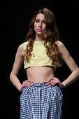 ZAGREB, CROATIA - APRIL 12 : Fashion model wears clothes made by Twins on