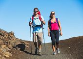 Hikers enjoying walk on amazing mountain trail. Backpacking in Haleakala volcano, incredible view. C