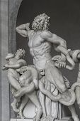 stock photo of snake-head  - Statue of Heracles fighting a giiant snake Capitoline Rome Italy 2014 - JPG