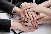 stock photo of nonverbal  - A pile of hands of businessman during a meeting - JPG