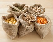 image of pea  - hessian bags with peas chick peas red lentils wheat and green mung on table - JPG