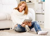 beautiful woman sitting and using tablet computer