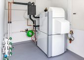 pic of boiler  - A boiler room with a heating oil warm water system and pipes - JPG
