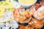 stock photo of tiger prawn  - Fresh fried Tiger Prawns on a spit - JPG