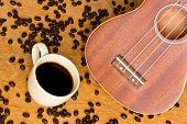 image of ukulele  - Coffee and Ukulele on a wood background - JPG