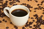 foto of coffee grounds  - Cup of black coffee and coffee beans on wooden background - JPG