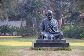 stock photo of gandhi  - Sitting posture statue of Mahatma Gandhi at Sabarmathi Ashram Ahmedabad Gujarath India Asia - JPG