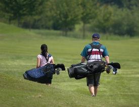 picture of golf bag  - couple walking down fairway  - JPG