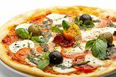 stock photo of pesto sauce  - Pizza with Mozzarella Cheese and Fresh Tomato and Pesto Sauce - JPG
