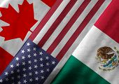 stock photo of trade  - Close up of the flags of the North American Free Trade Agreement NAFTA members on textile texture - JPG