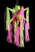stock photo of pinata  - traditional pinata star shape from mexico isolated on black background important part of parties and celebrations in mexican culture very popular during posadas parties and independence day - JPG