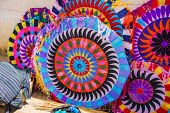 picture of kites  - Colorful handmade kites for sale on the street - JPG