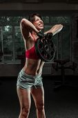 pic of kettling  - Fitness woman swinging kettle bell at gym - JPG