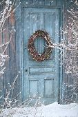 stock photo of christmas wreath  - Christmas holiday background with barn door and wreath - JPG