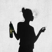 picture of teen smoking  - Shadow of girl with cigarette and bottle of wine smoking around on wall background - JPG