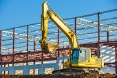 image of backhoe  - backhoe digging at a construction site building a bucket - JPG