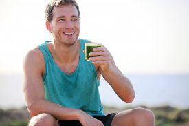 picture of cold drink  - Green smoothie man drinking vegetable juice after running sport fitness training - JPG