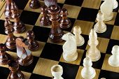 picture of chess piece  - playing wooden chess on the chess board - JPG