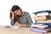 pic of overwhelming  - young stressed student girl studying pile of books on library desk preparing MBA test or exam in stress feeling tired and overwhelmed in youth education concept - JPG