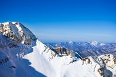 picture of caucus  - Sochi winter landscape of Caucasus mountains during daytime in ski resort of Krasnaya polyana - JPG