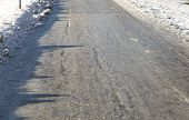 image of icy road  - Icy Road in Winter with bicycle tracks - JPG