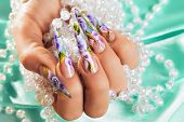 image of nail-design  - Female hand with beautiful floral design on nails - JPG