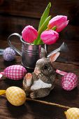 picture of figurines  - easter decoration with rabbit figurine eggs and tulips in watering can on wooden background - JPG