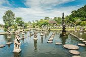 foto of fountain grass  - Tirtagangga water palace with fountains  and ponds on Bali - JPG