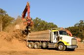 stock photo of track-hoe  - Track hoe excavator loading a 10 - JPG