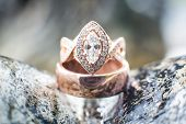 picture of diamond ring  - Beautiful diamond wedding and engagement rings on a rock - JPG