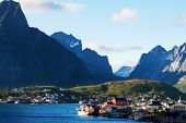 stock photo of lofoten  - Scenic town of Reine by the fjord on Lofoten islands in Norway on sunny summer day - JPG