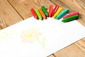 picture of montessori school  - Crayons lying on a paper with children - JPG