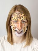 stock photo of face painting  - Young blond slav girl with face painting panther - JPG