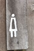 stock photo of female toilet  - Signs symbolize the female toilet on wood backgrounc - JPG