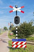 picture of railroad-sign  - railroad crossing sign with warning lights in Rotterdam - JPG