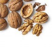 foto of walnut  - walnut and a cracked walnut isolated on the white background with clipping path - JPG