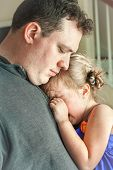 stock photo of comfort  - sad father comforting his crying preschool age daughter - JPG