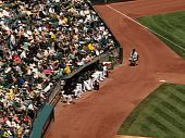 Oakland Athletics Pitchers Sit The The Bullpen With Fans Sittint Behind Them