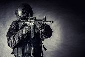 picture of war terror  - Spec ops police officer SWAT in black uniform and face mask - JPG