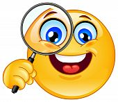 image of smiley face  - Design of an emoticon holding a magnifying glass - JPG