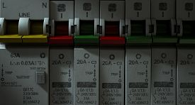 pic of breaker  - A row of switched off household electrical circuit breakers on a wall panel - JPG