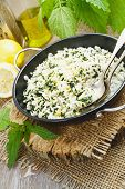 foto of nettle  - Risotto with nettles and lemon in the frying pan - JPG