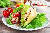 image of tacos  - Tasty taco with vegetables on plate on table close up - JPG