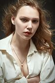 picture of thinkers pose  - sad pretty woman portrait on black background - JPG