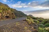pic of curvy  - Scenic curvy road with fence on sunset Tenerife Canary islands - JPG